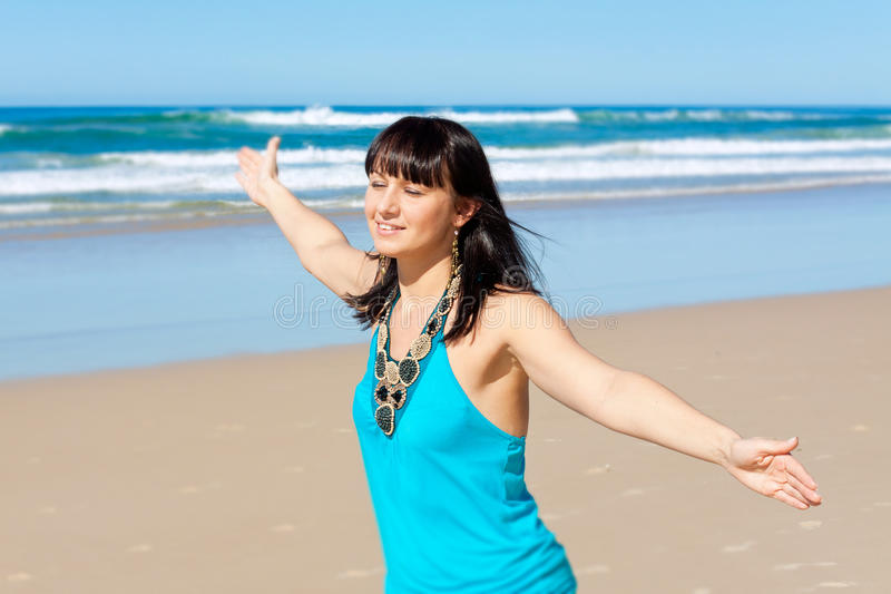 Young woman enjoys her time on the beach stock images