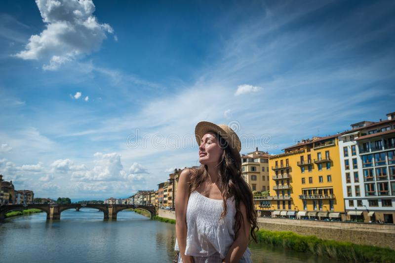 Young woman enjoys holidays in Florence, Italy stock photo