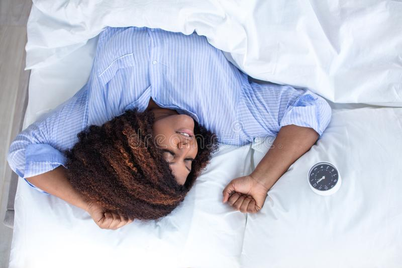 Young woman enjoys sleeping, top view stock photography