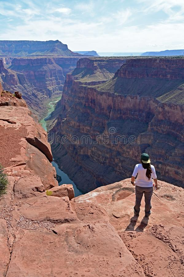 Young woman at Toroweap Overlook in the Grand Canyon. Young woman enjoys the spectacular view from Toroweap Overlook in Grand Canyon National Park, Arizona stock images