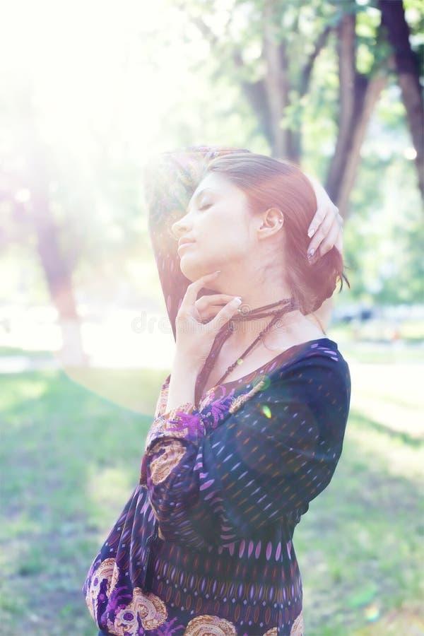 Free Young Woman Enjoys Sun Beams At Spring Park Royalty Free Stock Photo - 14507155