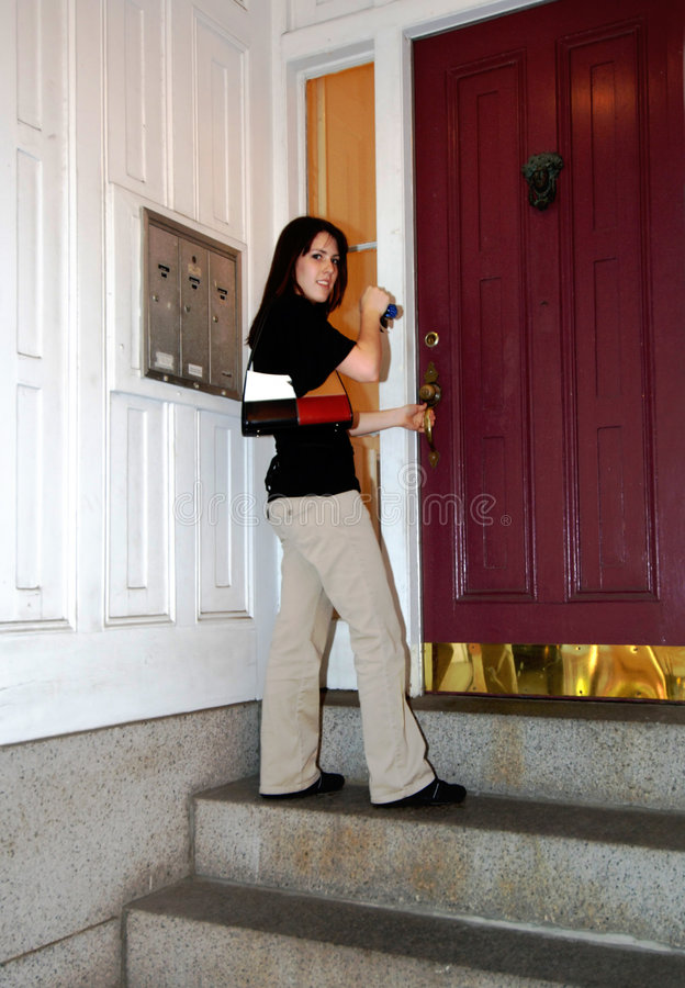 Free Young Woman Entering City Apartment Stock Image - 6283711