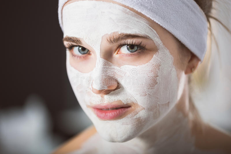 Young woman at enzymatic peeling therapy in spa. Woman during spa treatment with mask on her face royalty free stock images