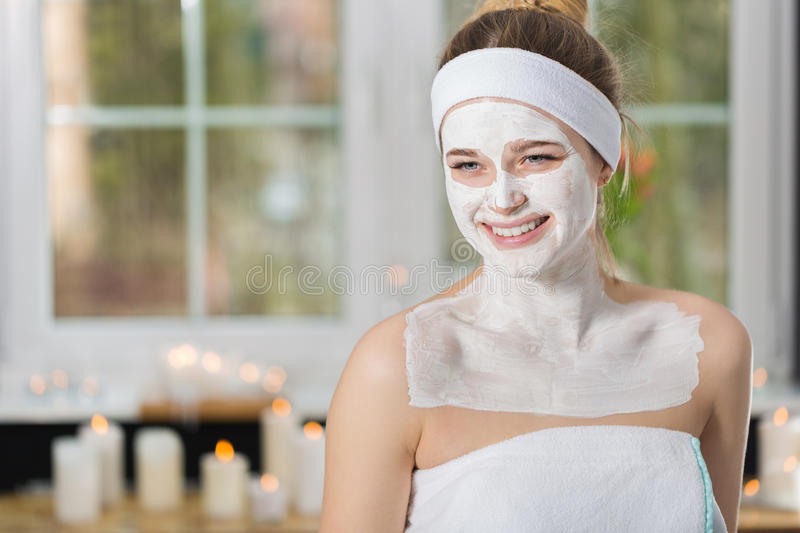Young woman at enzymatic peeling therapy in spa. Woman during spa treatment with mask on her face stock photo