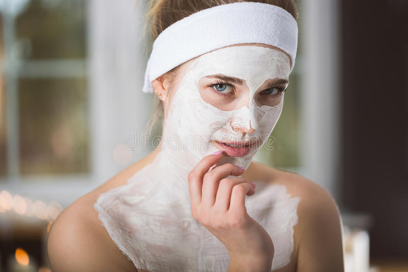 Young woman at enzymatic peeling therapy in spa. Woman during spa treatment with mask on her face stock photos