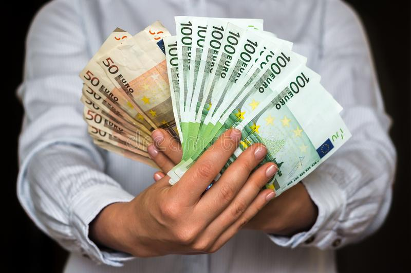 Young woman with euro money banknotes royalty free stock photo