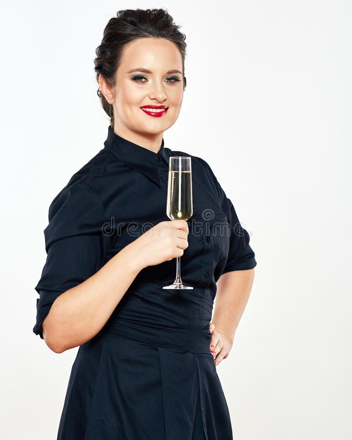 Young woman in evening black dress hold wine glass. female model royalty free stock photo