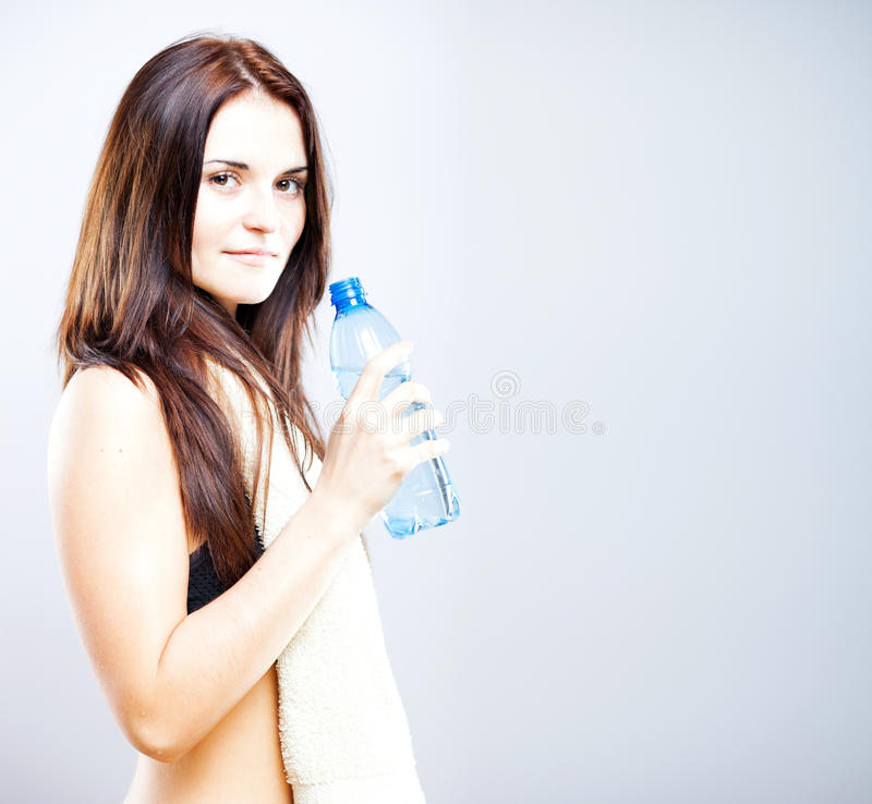 Young woman after exercise with bottle of water stock images