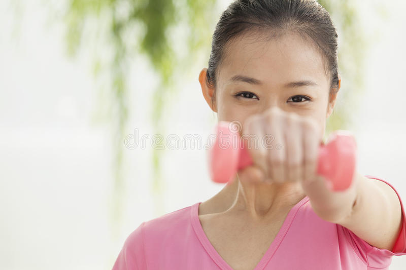 Young woman exercise in the park royalty free stock photos