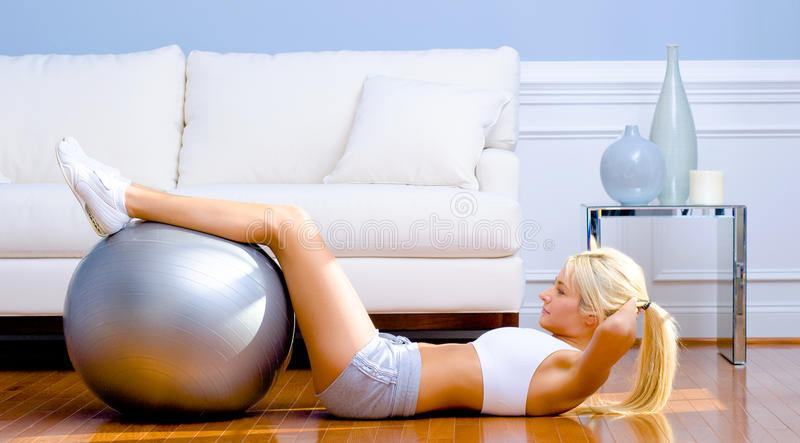 Download Young Woman Exercising stock photo. Image of indoors - 12564514