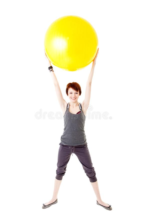 Download Young Woman Exercising On A Fitness Ball Stock Image - Image: 13218817
