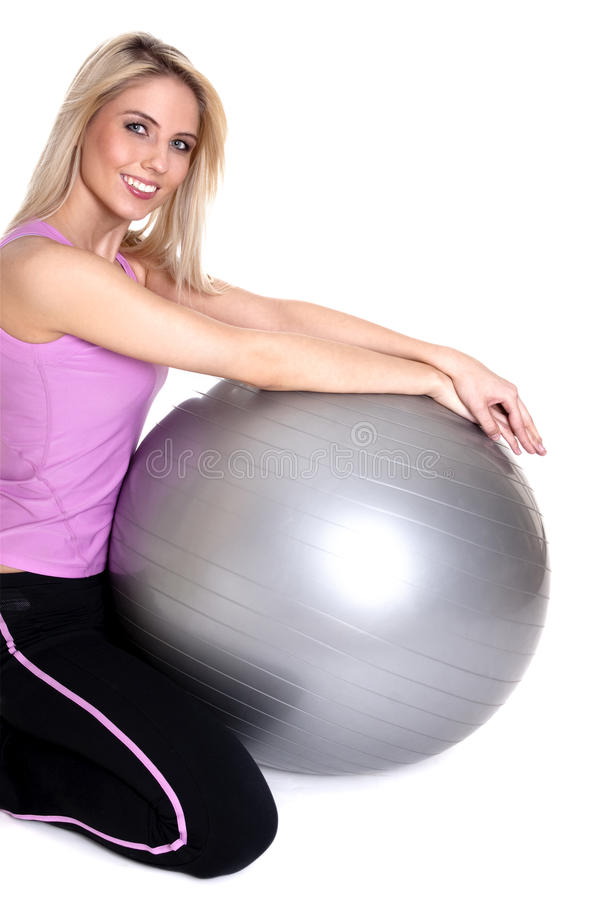 Young woman exercising on fitness ball royalty free stock image
