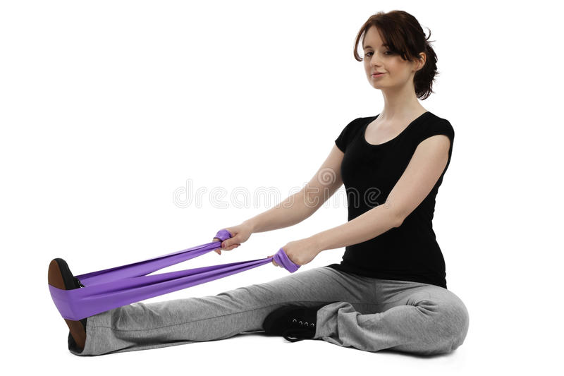 Young woman exercising gymastics with ribbon stock images