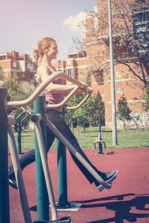Young woman exercising outdoors. stock photography
