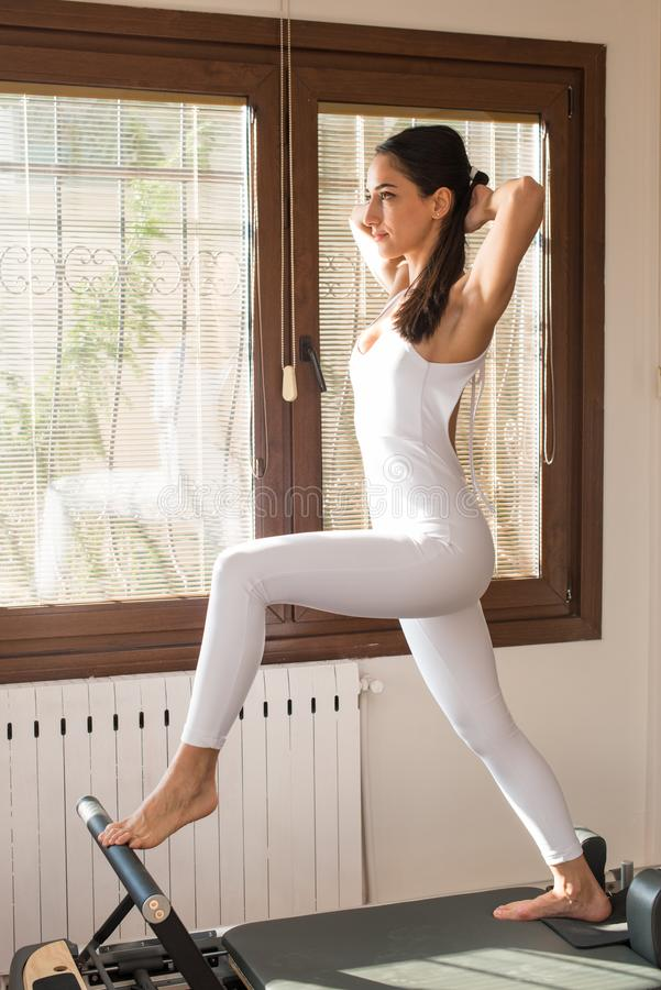 Peak Pilates - Pilates Trainer Exercising on Peak Pilates Reformer stock images