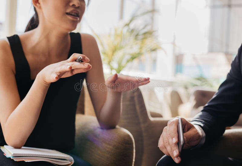 Young woman explaining business idea to businessman stock images
