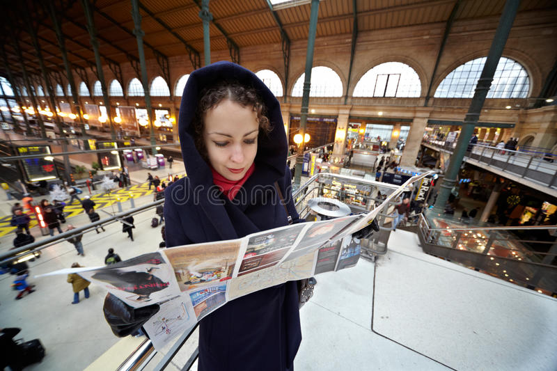 Young woman explores map of Paris royalty free stock photo