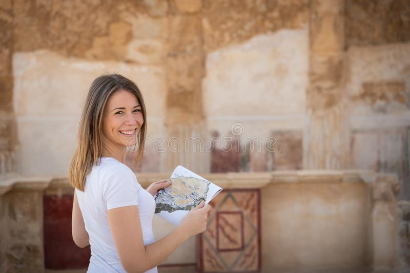 Young woman exploring the ruins of masada in israel. Tourist exploring the ruins of masada in Israel during a sunny day stock photos