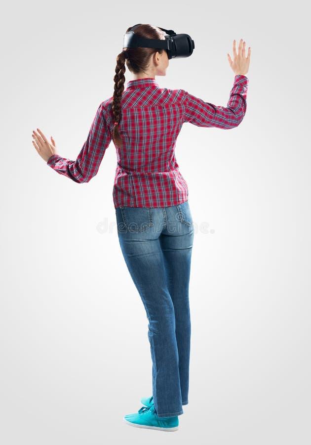 Young woman exploring virtual world stock image
