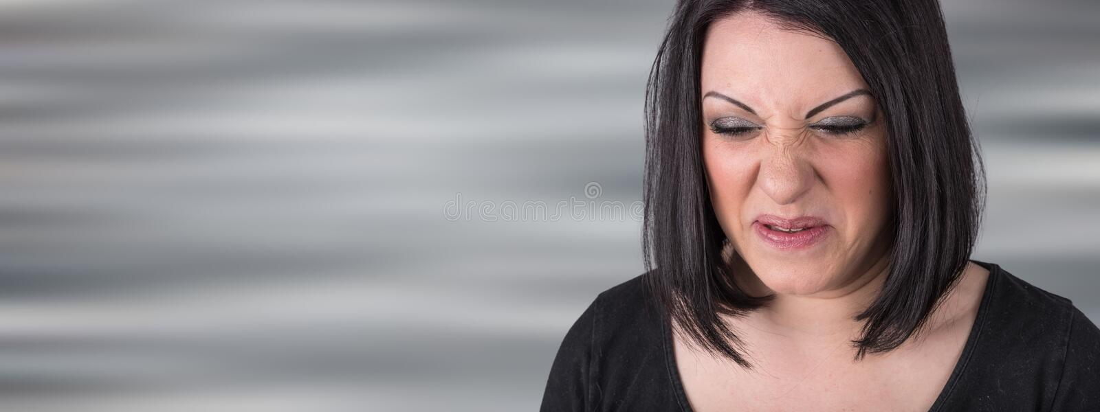 Young woman with an expression of disgust stock photography