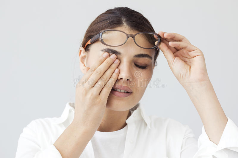 Young woman with eye fatigue stock photo