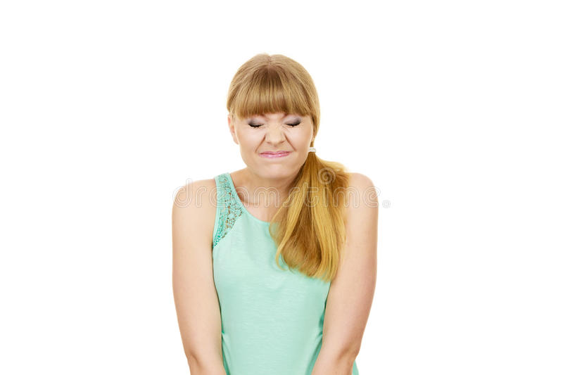 Young woman eyes mouth closed funny face expression stock photography