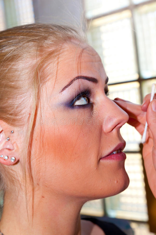 Young woman face with applying natural beauty make-up stock images