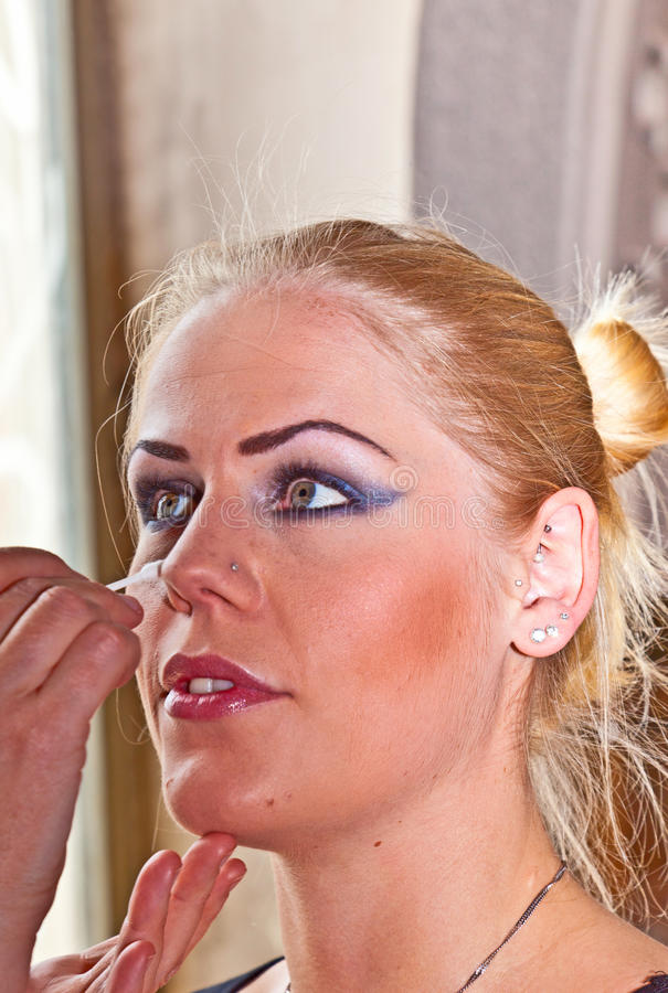 Young woman face with applying natural beauty make-up stock photography