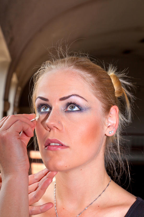 young woman face with applying natural beauty make-up stock photo