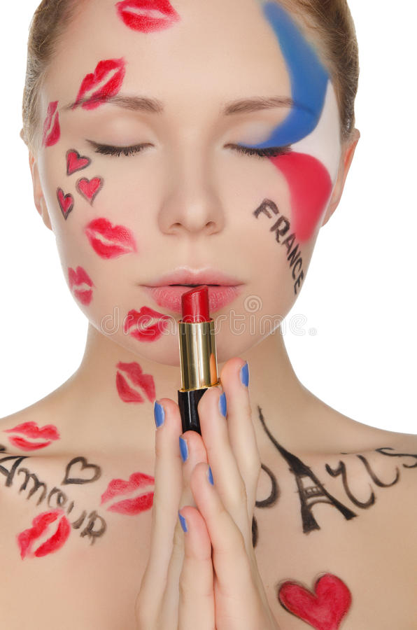 Young woman with face art on theme of Paris royalty free stock photography