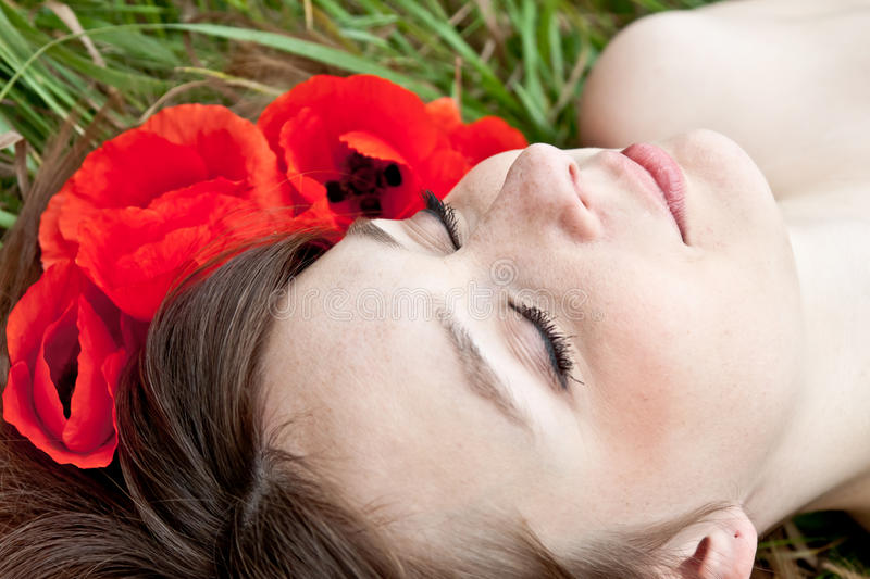 Young woman face in flowers royalty free stock image