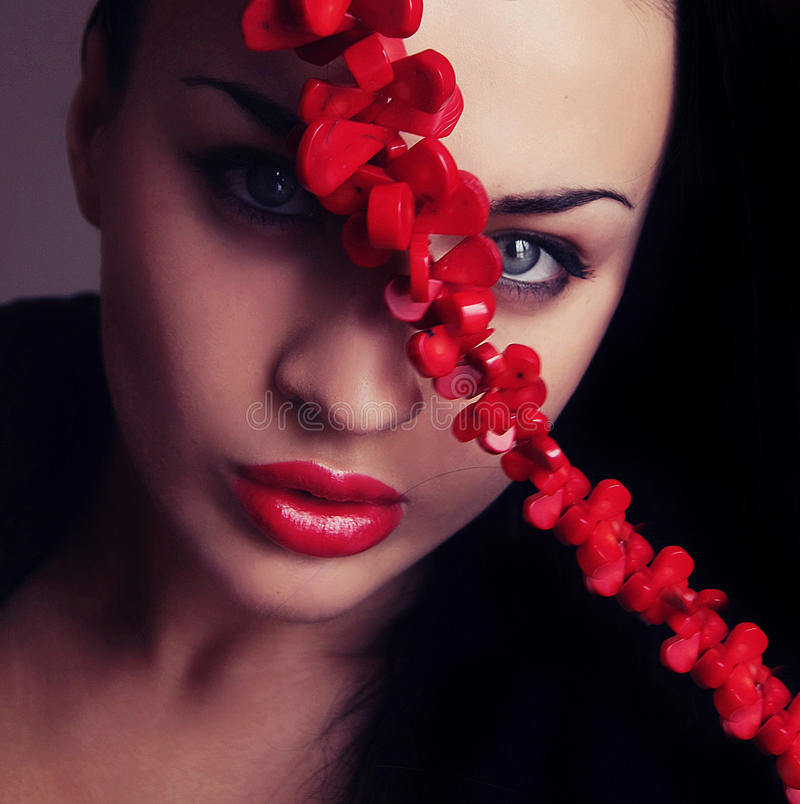 Young woman face with red lips and cross belt stock photo