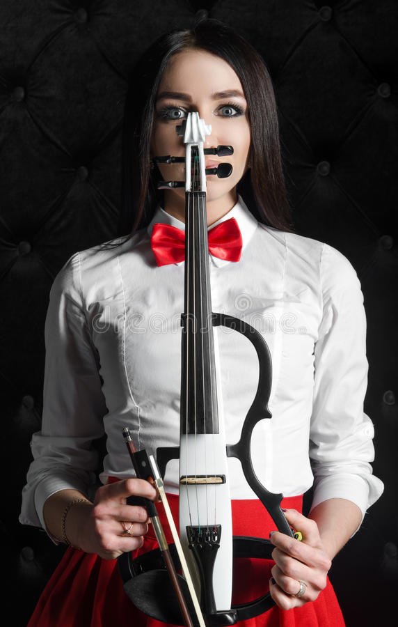 Young woman face with a violin stock photo