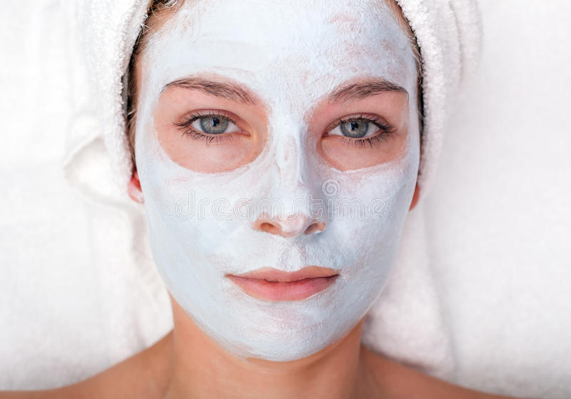 Young woman with facial mask stock image