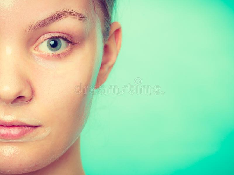 Woman in facial peel off mask royalty free stock images