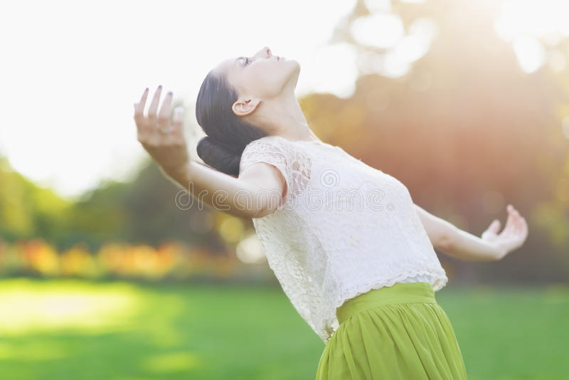 Young woman falling on meadow stock image