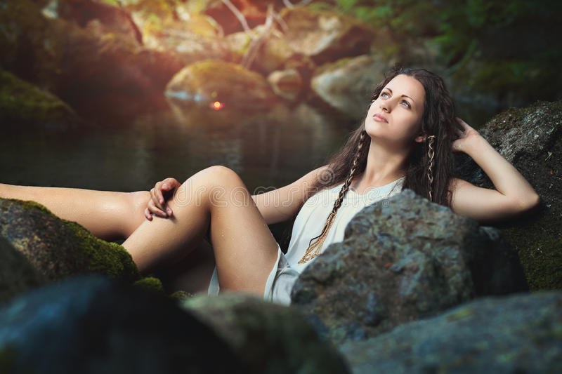 Young woman in a fantasy stream stock photo