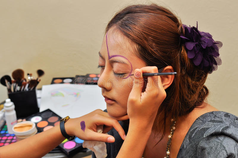 Young woman with fashion make-up by a beautician stock photos