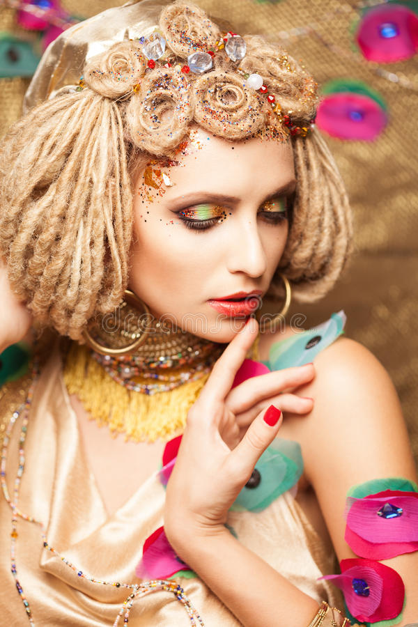 Young woman with fashion makeup on brown stock photography