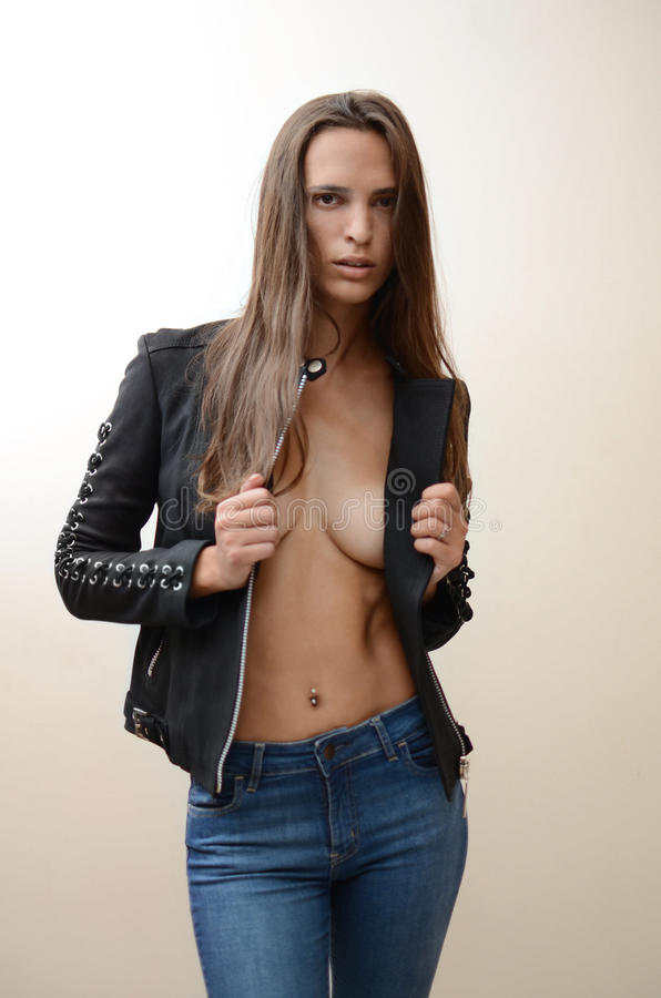 Young Woman Fashion Model in black jacket stock image