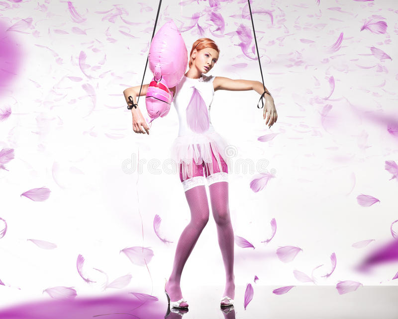 Young woman fashion. On pink background. royalty free stock photo