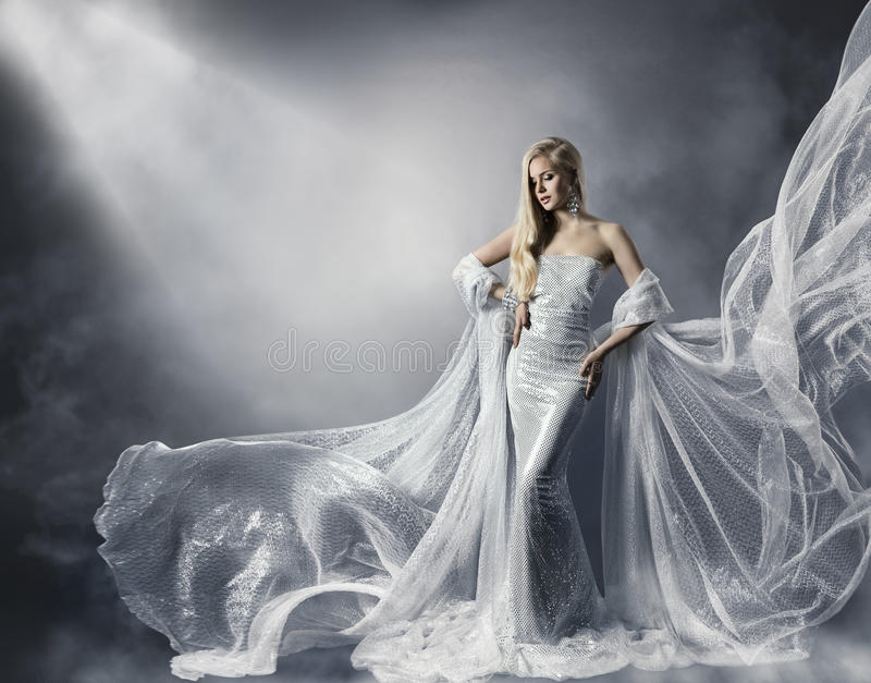 Young Woman in Fashion Shiny Dress, Lady in Flying Clothes, Girl under Star Light stock photo