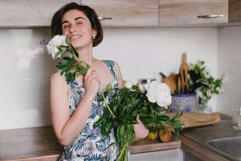 Young woman in fashon dress holding bouquet of beautiful white peonies flowers royalty free stock photos