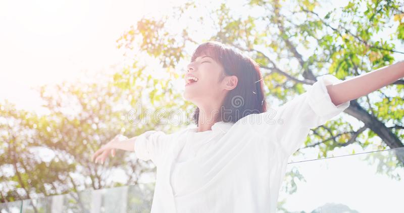 Young woman feel carefree. And take a deep breath at nature outdoor stock photography
