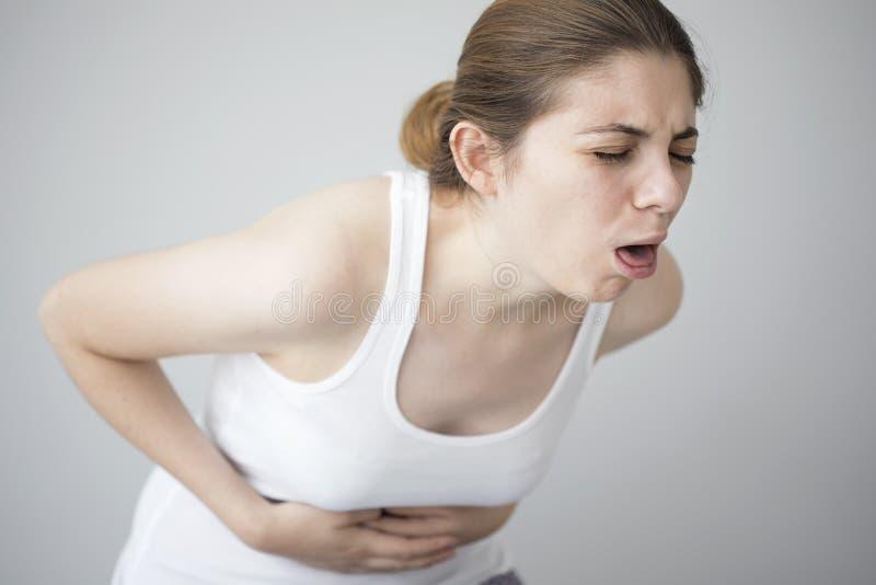 Young woman feeling nauseated stock image