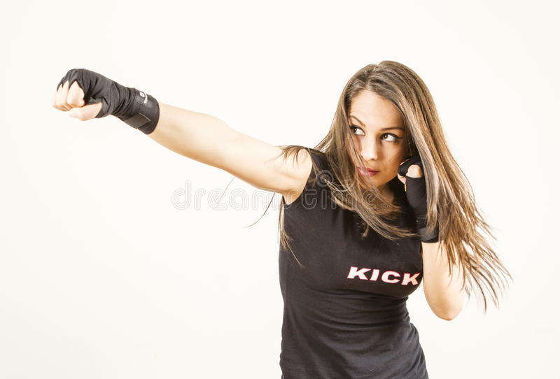 Young woman fighter. Young woman boxer fighter - strong look stock photo