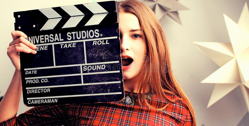 Young woman film director portrait. Beautiful purple colors on the face of the girl stock image