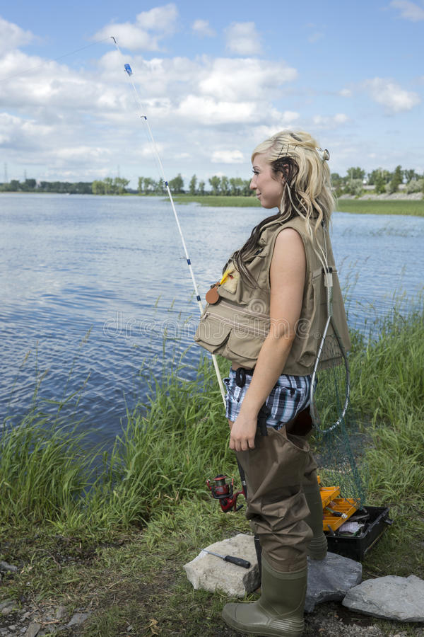 Young woman fishing stock images