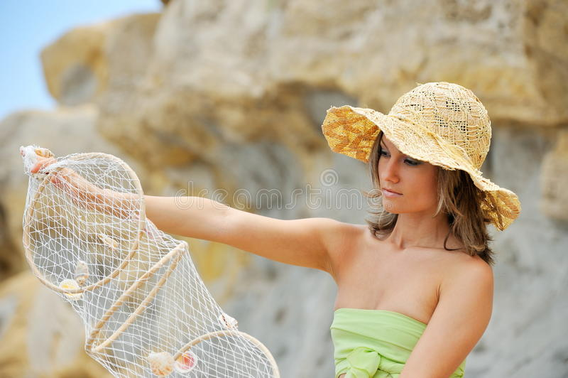 Download Young Woman With Fishing Net Stock Photo - Image: 9825414