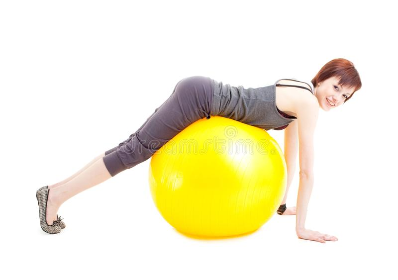 Young woman on a fitness ball